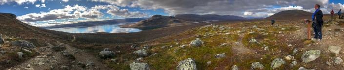 panoramic view of hills and lake