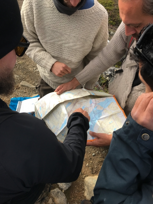 group looking at a map of Saana
