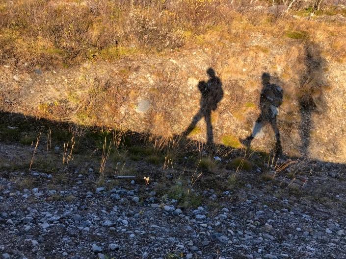 shadow portrait of two people walking