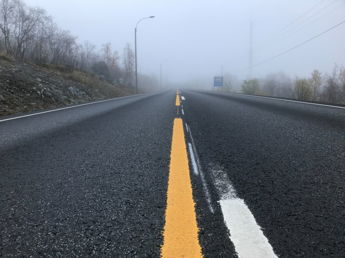 view down foggy empty road